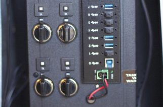 Image 1: The upper left side of the Kendrick Model 208-IPP-C-3.0 Imaging Power Panel contains four 12-volt automobile-type outlets (two 5-amp, one 7-amp and one 10-amp). Other voltages are available by special order. The right side contains eight USB-3.0 ports (seven powered ports, plus one USB Standard B port). The bottom of the panel contains an LCD readout, an on/off switch and an Anderson-type jack for external power.