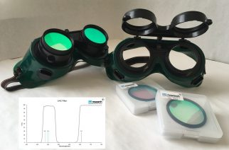 Observing Goggles with Pair of 2-inch Filters. Towards the right shows the goggles and the filters still in their packages, while on the left shows the filters installed. Note the filters can flip up and out of the way.